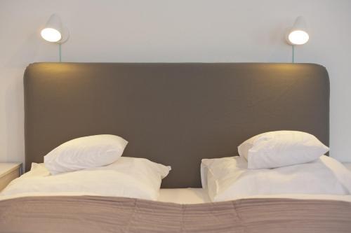 Ein Bett oder Betten in einem Zimmer der Unterkunft Elisabeth Bräu