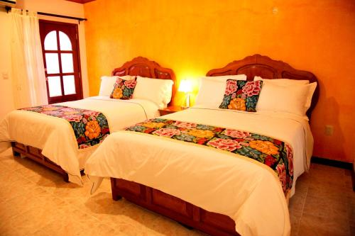 A bed or beds in a room at Departamentos K&B