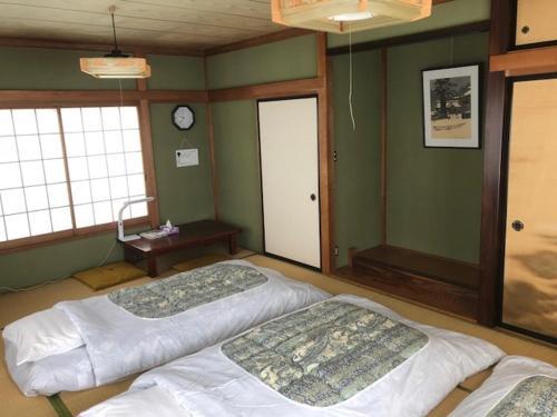 Cama o camas de una habitación en Tamaki