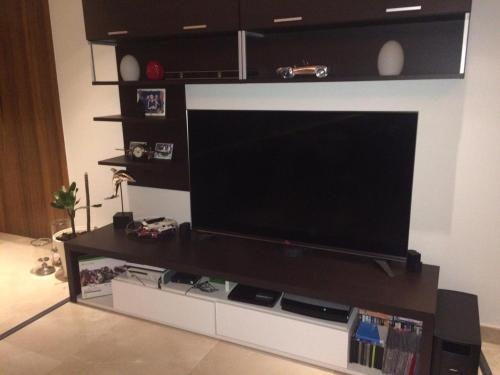 A television and/or entertainment center at 4 BR + Maid Luxurious Apartment in The Palm Jumeirah