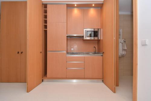 Cuisine ou kitchenette dans l'établissement Reis de Gaia