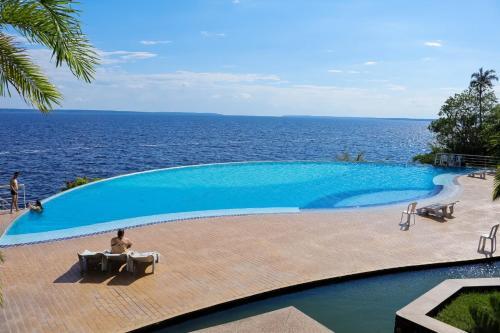 The swimming pool at or near Flats Tropical com Varanda
