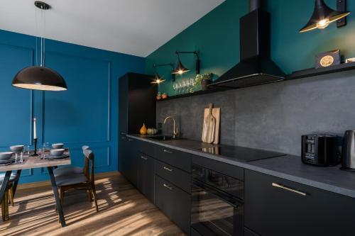 Kuchnia lub aneks kuchenny w obiekcie Elite Apartments Oliwa Martinique
