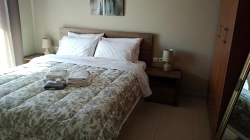 A bed or beds in a room at Iris Deluxe Suites 1