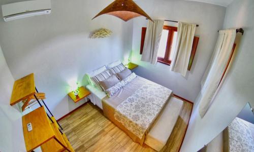 Een bed of bedden in een kamer bij Casinhas da Julieta