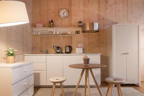 A kitchen or kitchenette at Apartments near metro station