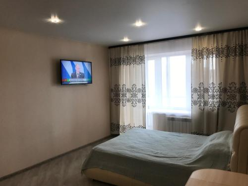 Кровать или кровати в номере Центральные Апартаменты