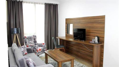 A television and/or entertainment center at Skyport Istanbul Hotel