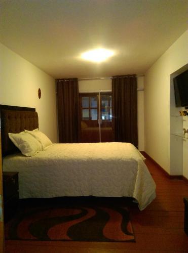 Cama o camas de una habitación en Kallpa Guest House