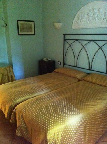 Letto o letti in una camera di Hotel Antica Foresteria Catalana