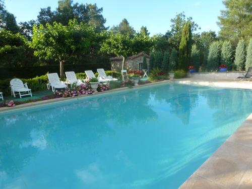 The swimming pool at or near DOMAINE DU PLANAS - ARCADES