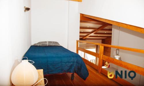 Rúm í herbergi á Apartamentos Con Terraza San Francisco De Borja