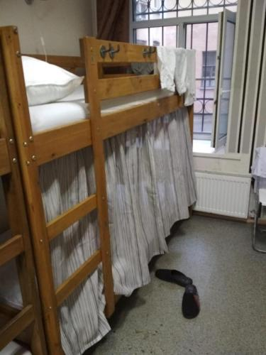 A bunk bed or bunk beds in a room at Moon Hostel