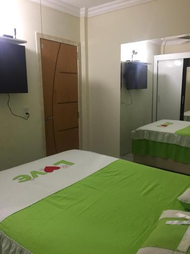 A bed or beds in a room at Apartamento Mobiliado em Cuiabá