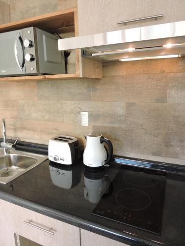 Kuchyňa alebo kuchynka v ubytovaní EcoLofts Croacia 1028