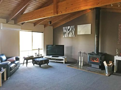 A television and/or entertainment center at Sandy Point Luxury Beach House