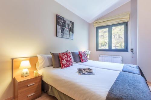 Кровать или кровати в номере Pierre & Vacances Andorra El Tarter
