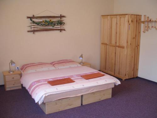 A bed or beds in a room at Skipension Jasná