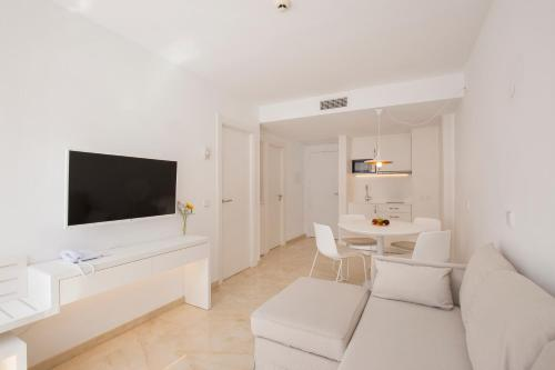 A seating area at Canyamel Sunrise Apartments