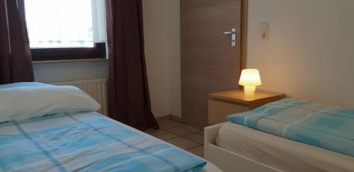A bed or beds in a room at flats-4u - Cosy, quite & clean apartments in the city ( Apt.4 )