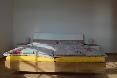 Ein Bett oder Betten in einem Zimmer der Unterkunft Franzlhof