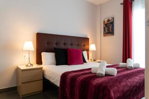 A bed or beds in a room at Dailyflats Raval