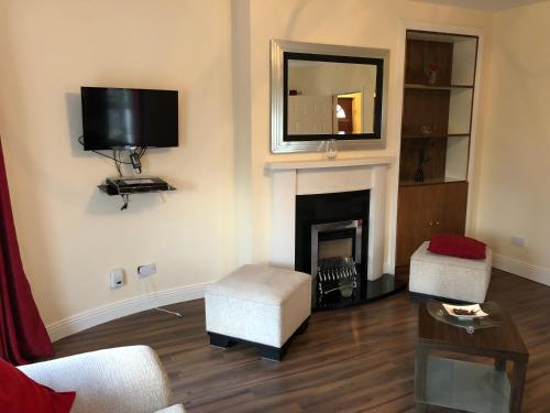 A television and/or entertainment center at Swords Airport Self Catering