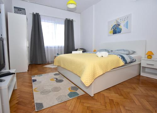 A bed or beds in a room at Sweet Story Central Apartment