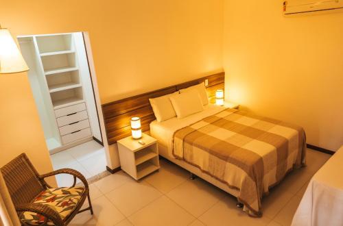 Cama ou camas em um quarto em Residencial Cores Do Arraial