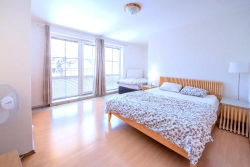 A bed or beds in a room at Apartment Vezenska