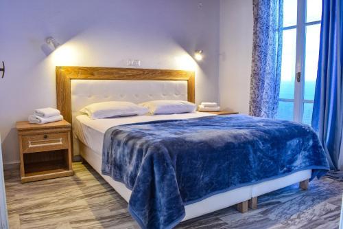 Ένα ή περισσότερα κρεβάτια σε δωμάτιο στο Villa Francesca