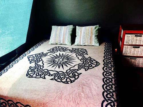 A bed or beds in a room at LaLuna Lodge