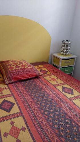 A bed or beds in a room at les 2 cocotiers