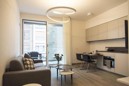 A kitchen or kitchenette at Design & New Center Apartments