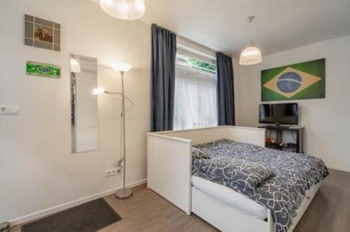 Ein Bett oder Betten in einem Zimmer der Unterkunft Bos en Lommer Hotel - Erasmus Park area