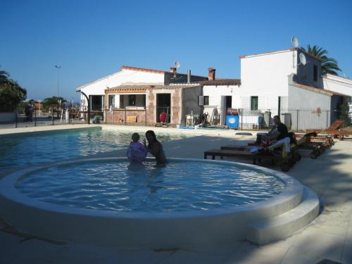 The swimming pool at or near Residence U Veniqui