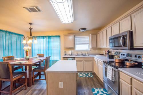 A kitchen or kitchenette at Helotes Family Retreat