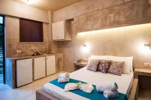 A bed or beds in a room at Zante Nest Studios & Apartments