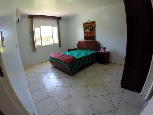 Cama o camas de una habitación en Casa na Lagoinha Florianópolis B2