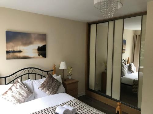 A bed or beds in a room at Trinity Apartments - 2A, 1-Bed Apt, Waterford City