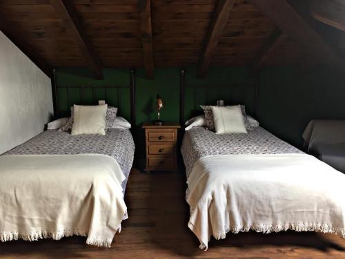 A bed or beds in a room at Apartamentos Turísticos Reserva de la Biosfera