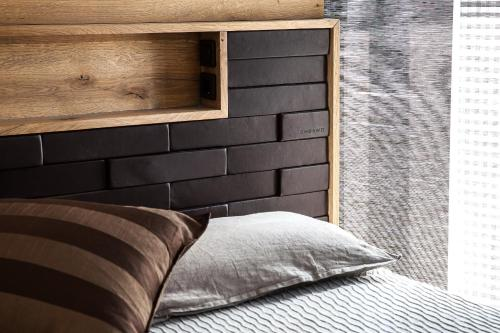 A bed or beds in a room at Embawo studio