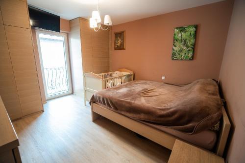 Postelja oz. postelje v sobi nastanitve Apartment House VaZaTaOr