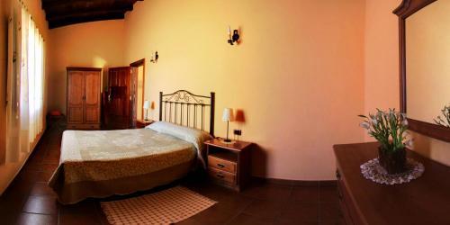 Een bed of bedden in een kamer bij Finca La Bonita