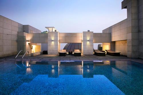 The swimming pool at or near Fraser Suites New Delhi