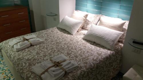 A bed or beds in a room at La Casetta di Francesco