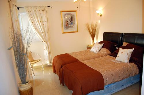 A bed or beds in a room at Villa Roque Del Conde, Las Americas, Tenerife