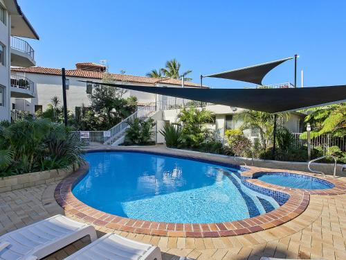 The swimming pool at or near 2 BED APT SAND CASTLES ON CURRUMBIN BEACH
