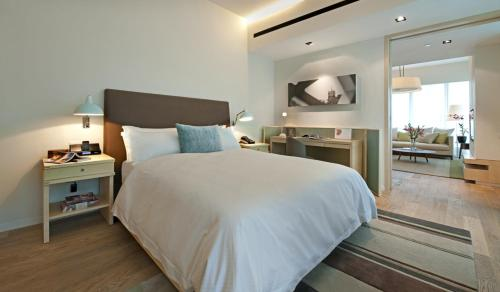 A bed or beds in a room at Lanson Place Bukit Ceylon Serviced Residences