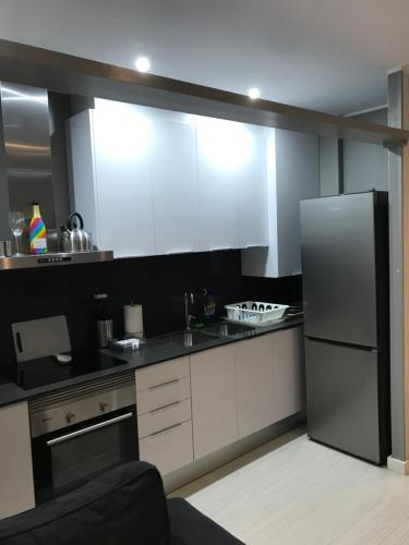 A kitchen or kitchenette at Mi Casa Su Hotel